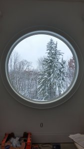 snow scene through porthole window.jpg